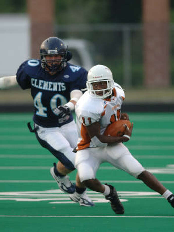 Dobie's Alex Joseph (11) outruns Clements' Bronson Fleig for a 15-yard gain in action Aug. 8. Photo: Eddy Matchette, For The Chronicle