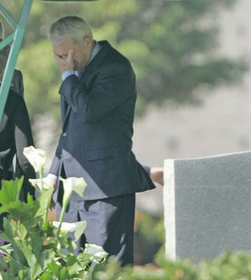 Former U.S. Rep. Mark Foley grieves Saturday at the burial service for his father, Edward Foley, 85, in Royal Palm Beach, Fla. Photo: WILFREDO LEE, AP