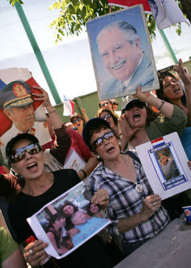 Supporters of Augusto Pinochet, 91, shout slogans Sunday outside a Santiago military hospital, where the former Chilean dictator was rushed after suffering a heart attack. Doctors initially planned bypass surgery, but opted for angioplasty. Photo: CLAUDIO POZO, AFP/Getty Images