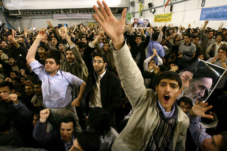 Iranian students show support during his visit to the Amir Kabir University in Tehran. Students from a reformist-led university association disrupted a speech by Ahmadinejad today, setting fire to his picture and heckling him. Photo: AFP/Getty Images