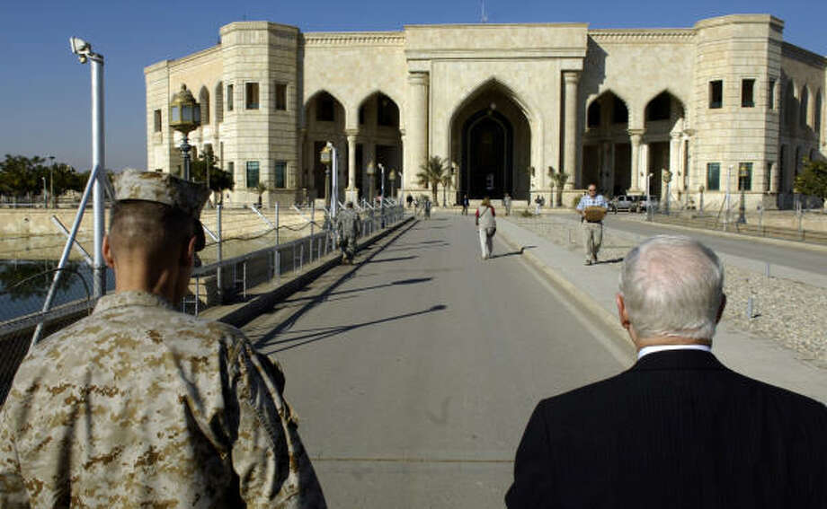 Defense Secretary Robert Gates, right, and Marine Gen. Peter Pace, chairman of the Joint Chiefs of Staff, walk toward the Multinational Corps-Iraq headquarters in Baghdad. Photo: CHERIE A. THURLBY, AFP/Getty Images