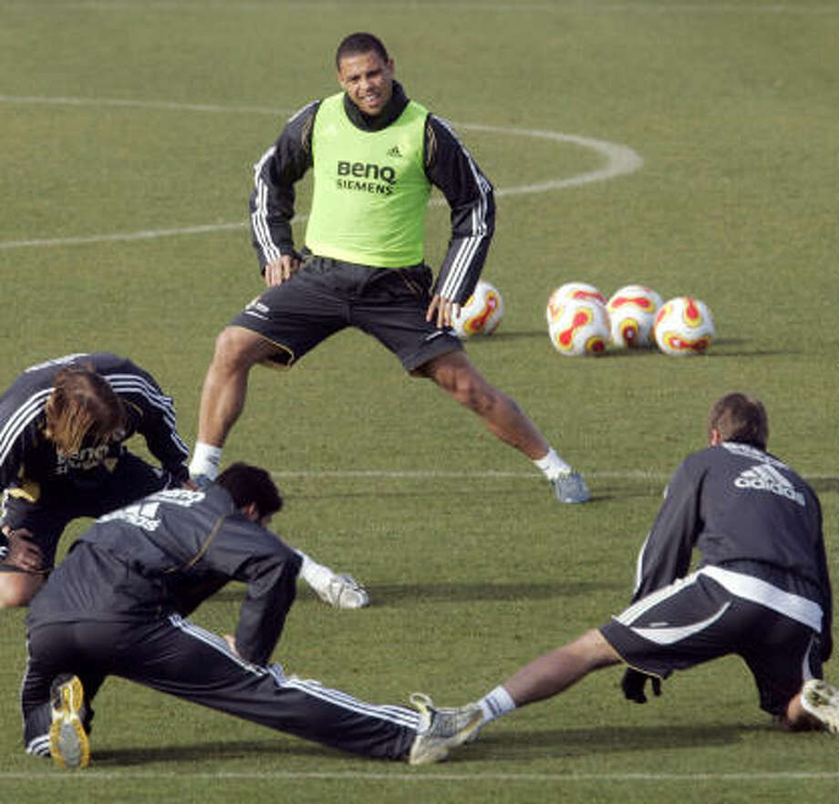 Brazilian star Ronaldo, top, could be a candidate to join David Beckham in MLS. (Beckham's working out at front right.) Photo: PAUL WHITE, AP