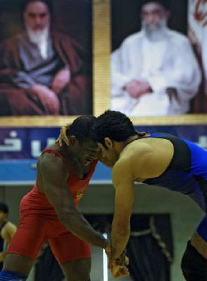 U.S. freestyle wrestler Anthony Ramico Blackmon, left, and Iran's Hamid Razani grapple Friday during the Persian Gulf Cup international wrestling tournament in Bandar Abbas, Iran. Photo: -, AFP / GETTY IMAGES