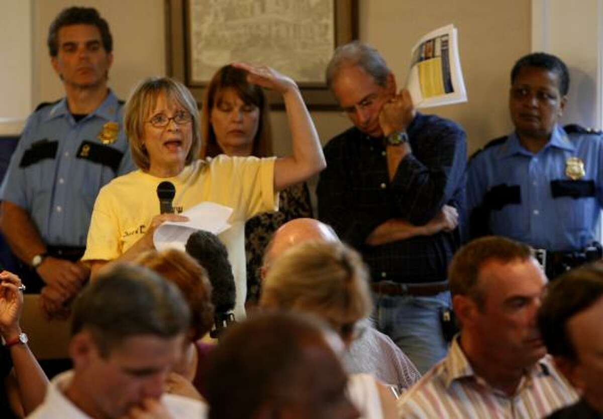 Homeowner Sheila Sorvari, founder of Save the Bungalows, asks Mayor Bill White a question about neighborhood preservation during a meeting last November in the Heights.