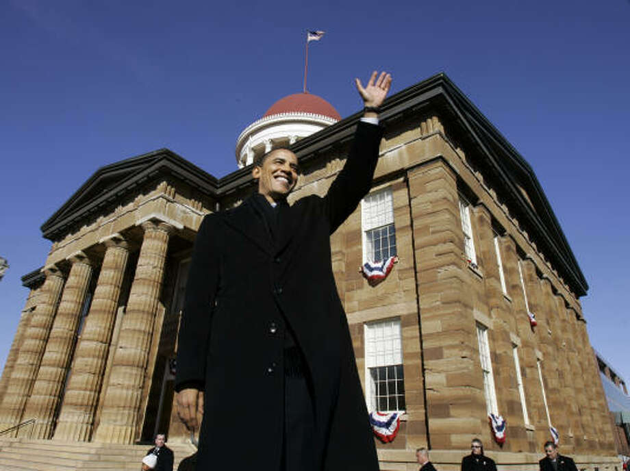 U.S. Sen. Barack Obama, D-Ill., waves to spectators as he arrives to announce his candidacy for president at the Old State Capitol in Springfield, Ill. Photo: Charles Rex Arbogast, AP