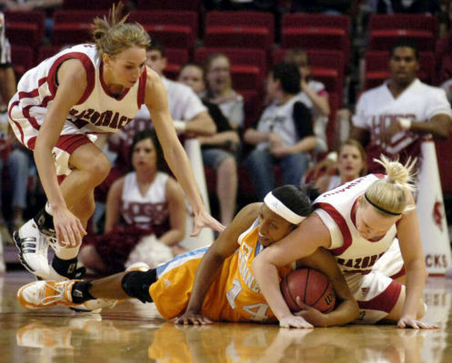 Alexis Hornbuckle and the Tennessee Vols got all the could handle from Arkansas' Leslie Howard, right, and Danielle Allen in an ovetime victory in Fayetteville. Photo: April L. Brown, AP
