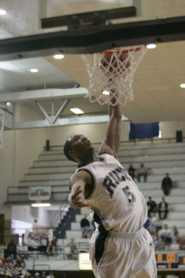 Rice's Lorenzo Williams converts a first-half steal into a dunk. Photo: Margaret Bowles, For The Chronicle
