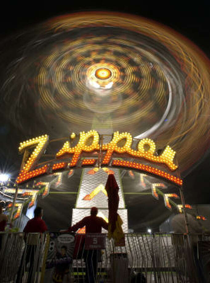 The Zipper spins on the carnival midway at the Houston Livestock Show and Rodeo on March 13, 2003. Photo: CHRONICLE File