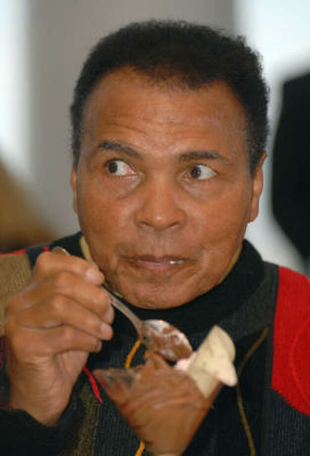 Muhammad Ali enjoys dessert after being wished a happy birthday Sunday at the cultural center in Louisville named after him. Photo: Brian Bohannon, AP
