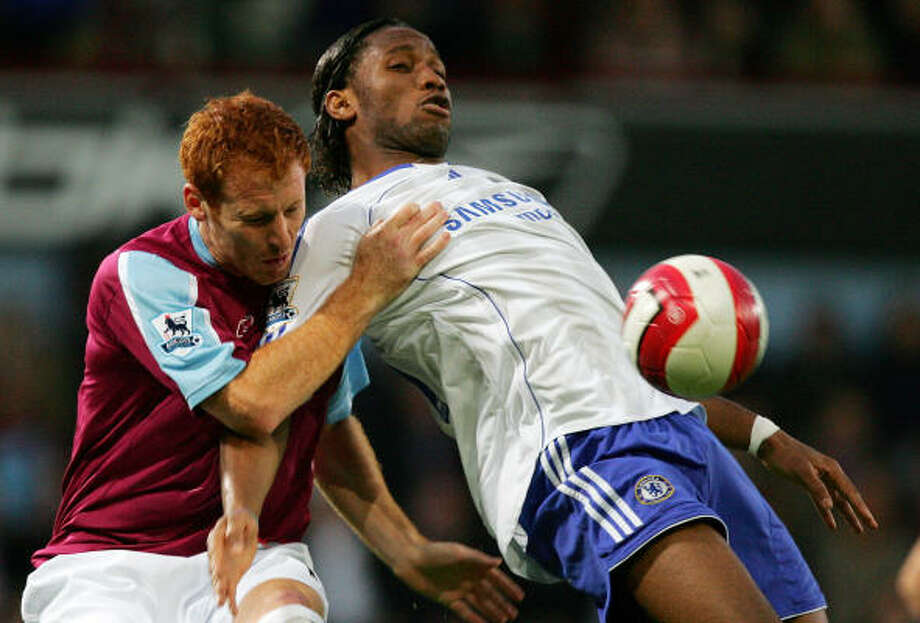 West Ham's James Collins, left, and Chelsea's  Didier Drogba fight for possession. Photo: CARL DE SOUZA, AFP/Getty Images