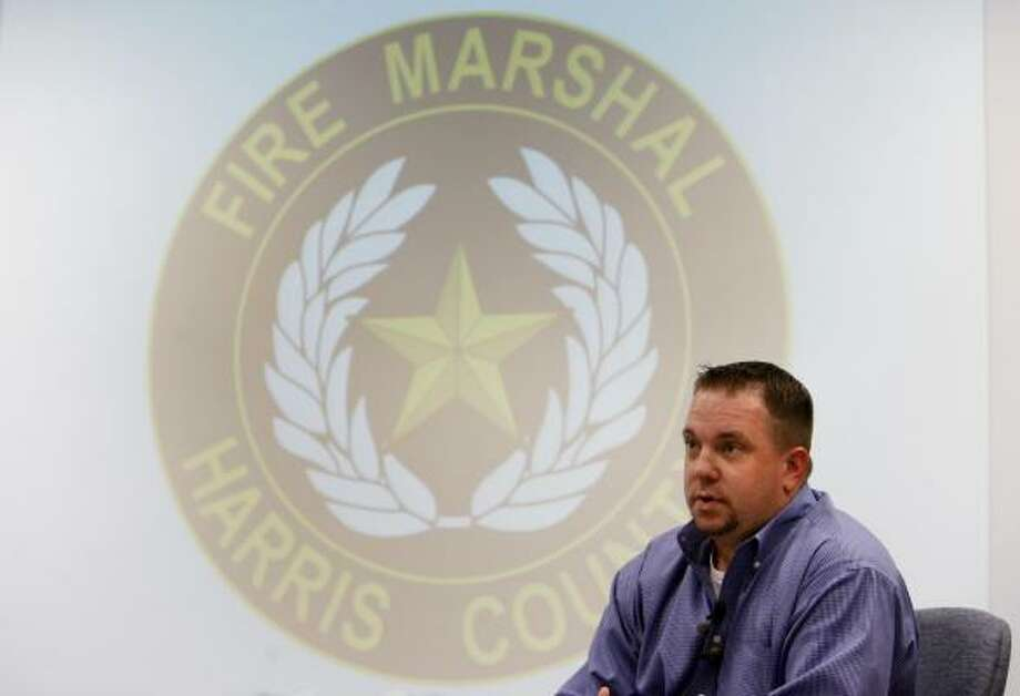 Senior investigator Dustin Deutsch speaks during a news conference about the arrest warrant issued for a Continental flight attendant and her husband in connection with an insurance fraud scheme at the Harris County Fire Marshal's Office in Humble on Thursday. Photo: Sharon Steinmann, Chronicle