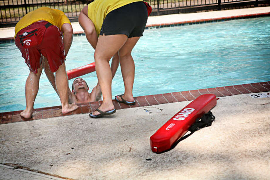 Corey Leopard, 17, takes part in a Water Wise Program water-rescue demonstration with fellow lifeguards. Photo: ERIN TRIEB, FOR THE CHRONICLE