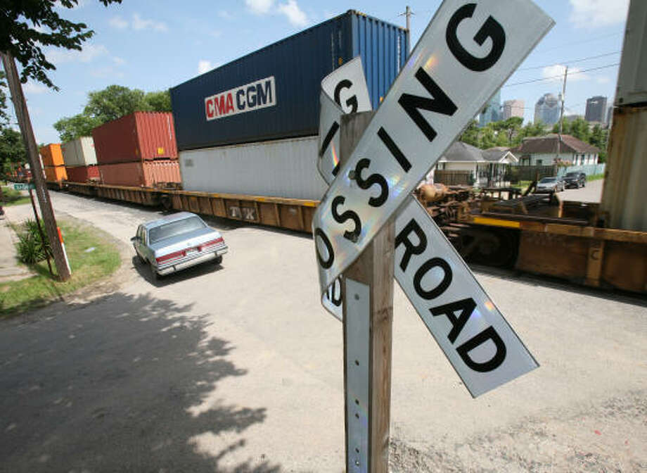 A railroad crossing at Sabine and Winter has only a sign without crossing arms or lights to warn cars or pedestrians. Photo: Steve Campbell, Chronicle