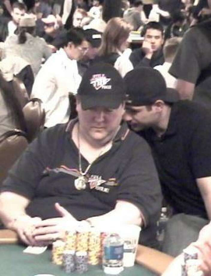 Blind poker player Hal Lubarsky, left, gets a little help from friend Jason Williams at the World Series of Poker's main event. Photo: STEVE LEVENTHAL