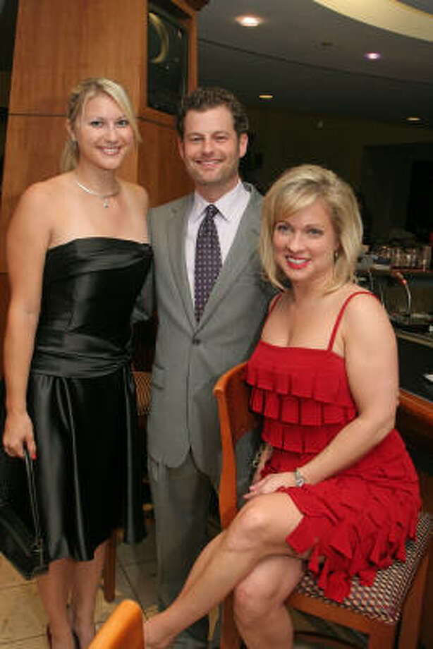 Kati Gercans, from left, Michael Conway and Darcy Walker at the Camp for All Casino Night fundraiser at Minute Maid Park. Photo: Gary Fountain, For The Chronicle