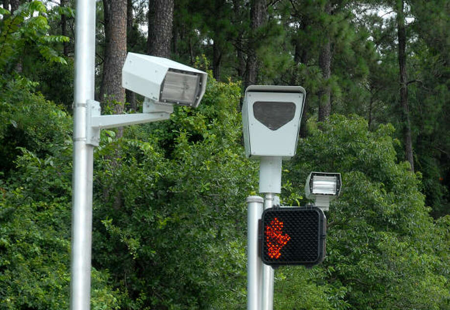 Recently installed red light cameras at Woodloch Forest Drive and Woodlands Parkway in June 2007. Montgomery County Precinct 3 installed the red light cameras. Photo: David Hopper, For The Chronicle