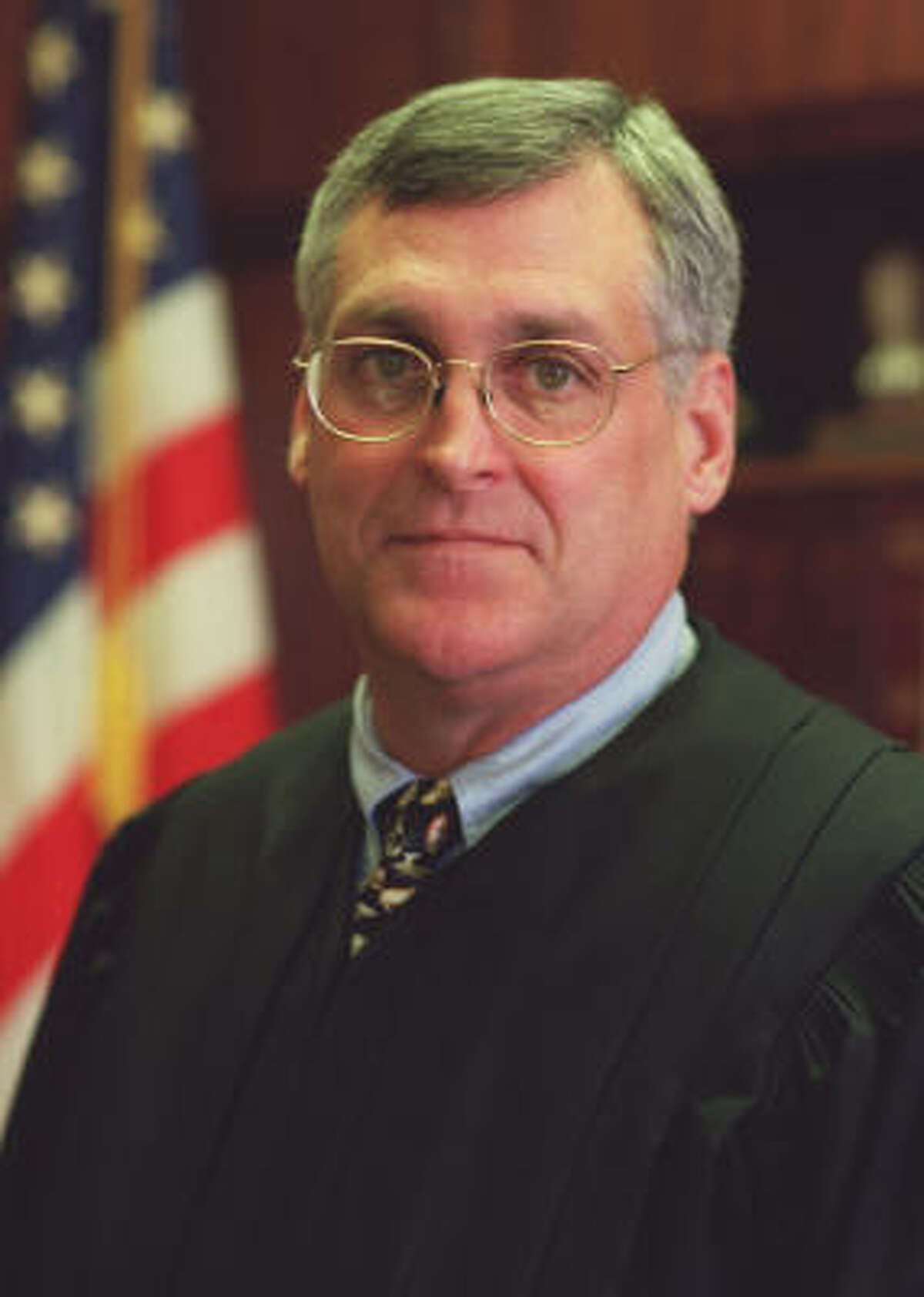 U.S. Federal District Judge Sam Kent, shown in 2001, is accused of harassing and inappropriately touching his 49-year-old case manager in his chambers in March.