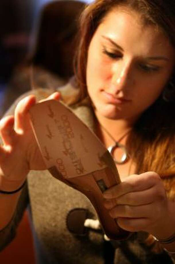Michaela Reynolds makes a shoe while being taught by Sissy Puccio Aversa in Rocky River, Ohio. Aversa has studios in several cities. Photo: SCOTT SHAW, NEWHOUSE NEWS SERVICE