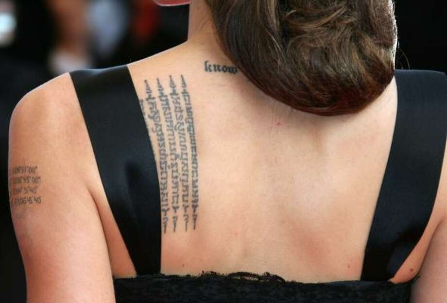 Anglena Jolie's tattoos can be seen during an appearance by the actress at Cannes in May. Tattoos are now so firmly mainstream that advertisers use them as a marketing tool. Photo: VALERY HACHE, AFP/GETTY IMAGES FILE