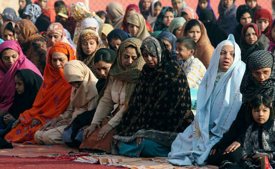 Pakistani women offer Eid prayers at a mosque in Lahore today.  At least 50 people were today in a suicide bombing at a mosque in northwest Pakistan targeting a former interior minister and close ally of President Pervez Musharraf. Photo: ARIF ALI, AFP/Getty Images