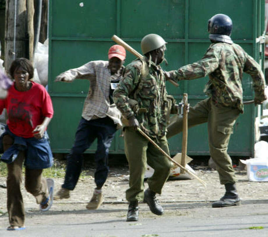 Kenyan riot police chase supporters of the Orange Democratic Movement (ODM) in Nairobi, Kenya, today. Photo: SAYYID AZIM, AP