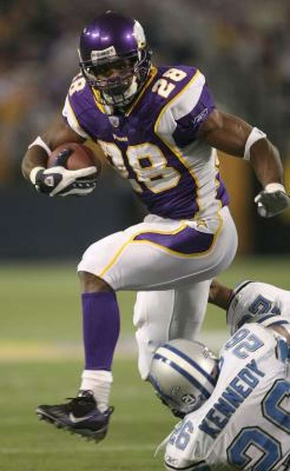 The Vikings' Adrian Peterson ran for an NFC-leading 1,341 yards. Photo: STEPHEN DUNN, GETTY