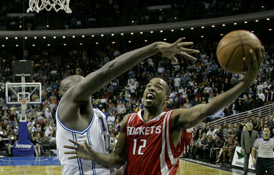Rafer Alston puts up the game-winning shot over Orlando's Adonal Foyle with 4.3 seconds left. Photo: John Raoux, AP