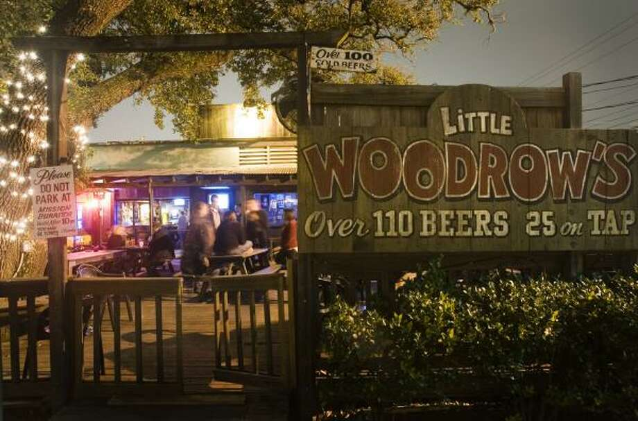 Regulars say they'll sit across the street and toast the West Alabama Little Woodrow's when demolition begins. The bar will close its doors March 2. Photo: SMILEY N. POOL, CHRONICLE