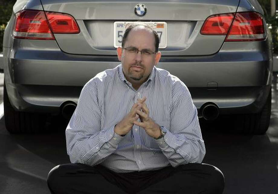 Trent Charlton is looking for someone to pick up the $550 monthly payments on his BMW 335i as he tries to pay off the loan on his 401(k). Photo: MARK AVERY, ASSOCIATED PRESS