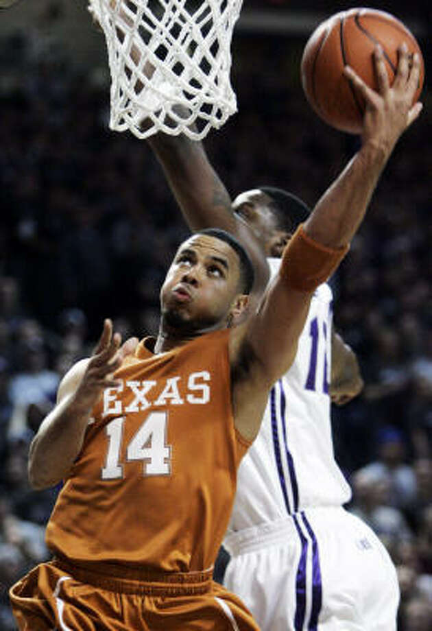 Texas guard D.J. Augustin (14) shoots while Kansas State forward Bill Walker defends during the first half. Photo: Orlin Wagner, AP