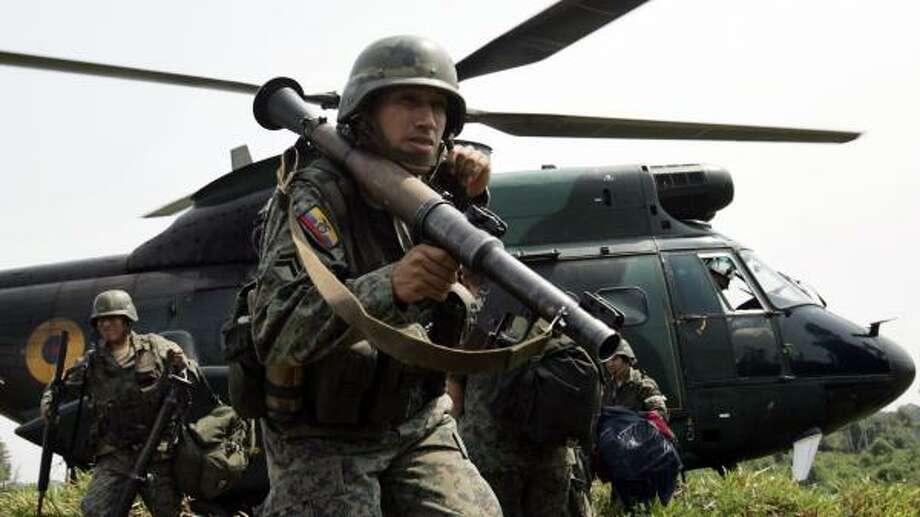 Ecuadorean President Rafael Correa sent soldiers to the Colombian border in response to a raid that killed a guerrilla leader. Photo: DOLORES OCHOA, ASSOCIATED PRESS