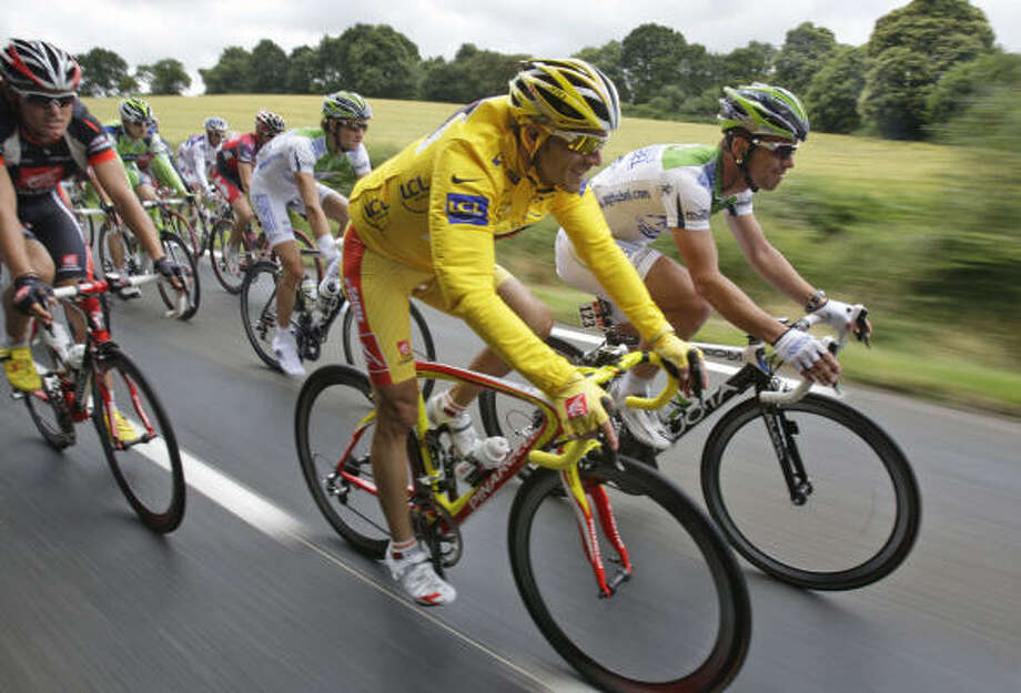 Spain's Alejandro Valverde, center, finished 12th on the second stage of the Tour de France, but kept the overall lead. Photo: Bas Czerwinski, AP