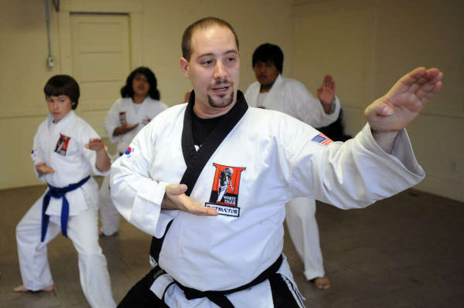 John Mueller, a third-degree black belt in Tang Soo Do karate, is the manager and trainer at White Tiger Martial Arts, which is temporarily operating out of Heights Presbyterian Church, 240 W. 18th St. Photo: Thomas Nguyen, For The Chronicle