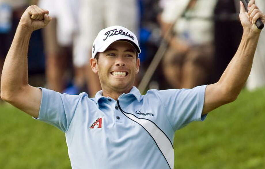 Chez Reavie celebrates after winning the Canadian Open golf championship. Photo: Ryan Remiorz, AP