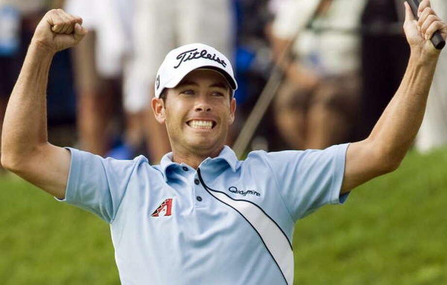 Chez Reavie celebrates after winning the Canadian Open golf championship. Photo: Ryan Remiorz, AP