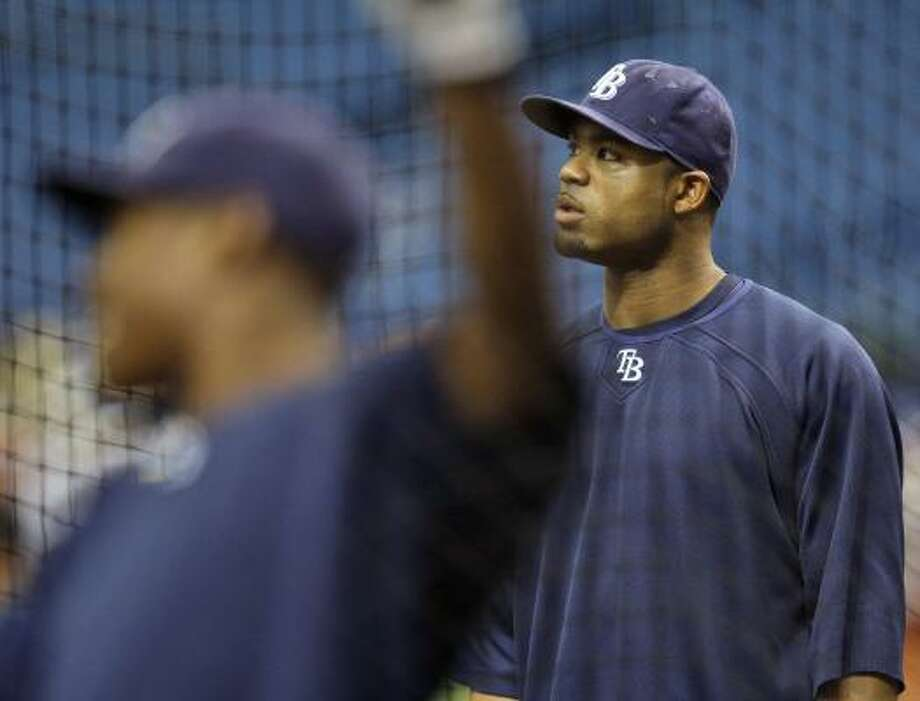 NO JITTERS: Carl Crawford, right, watches B.J. Upton take batting practice Wednesday. Crawford and Upton are two of the Rays short on playoff experience but not looking confidence. Photo: Chris O'Meara, AP