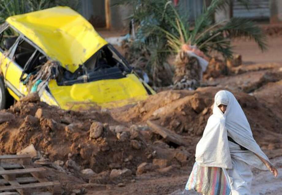 A resident passes destruction in Ghardaia on Friday. A flash flood killed at least 33 people in the desert town. Photo: FAYEZ NURELDINE, AFP/GETTY IMAGES