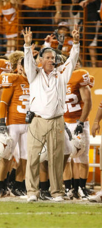 The BCS forced Texas head coach Mack Brown to do something on Thursday night that he'd prefer not to do, Richard Justice writes. Photo: Nick De La Torre, CHRONICLE