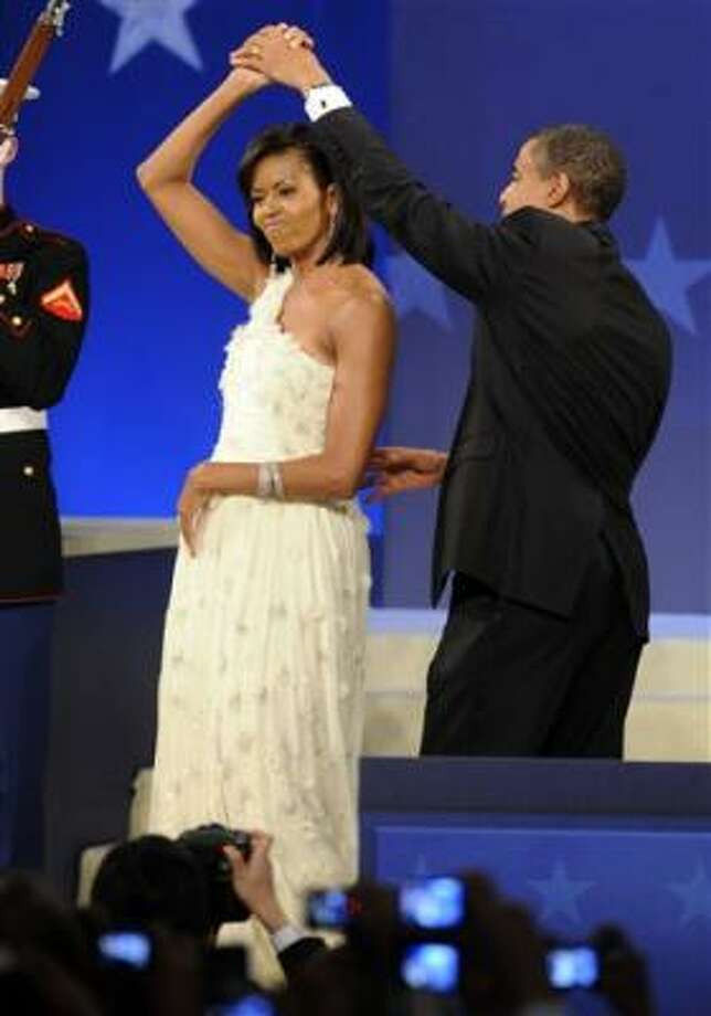 President Barack Obama and first lady Michelle Obama dance together at the Obama Home States Inaugural Ball in Washington on Tuesday. Photo: Susan Walsh, AP