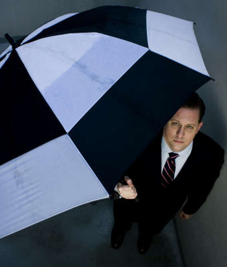Aaron Ball, a lawyer, fears the plan could harm small businesses and thus the work force. Photo: ERIC KANE:, CHRONICLE
