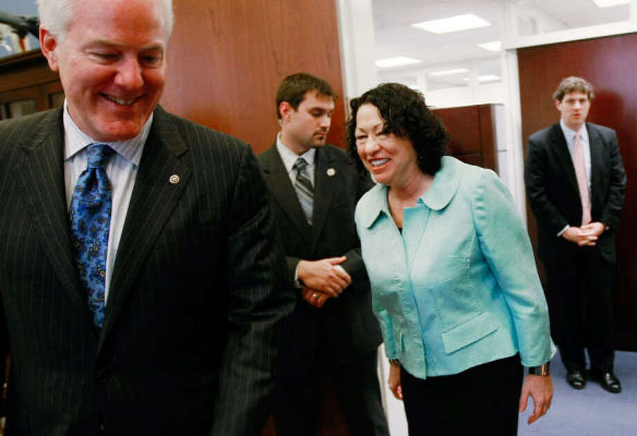 Judge Sonia Sotomayor meets with Sen. John Cornyn, left, in the Texas Republican's office as part of a round of visits she made Thursday on Capitol Hill. Photo: Mark Wilson, Getty Images