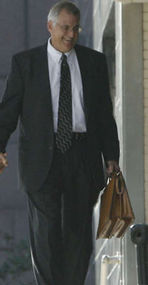 Samuel Kent (shown reporting to work last fall) has refused to resign. Photo: Julio Cortez, Chronicle