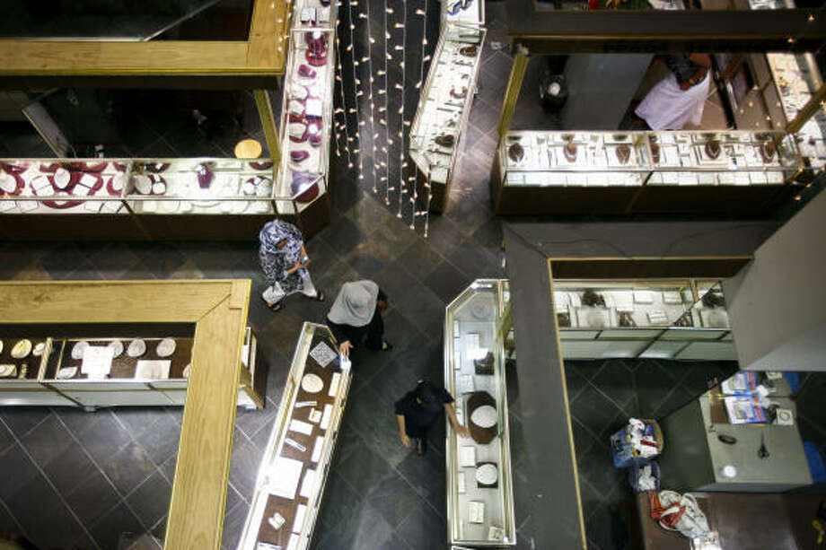 Customers shop this month amid showcases at Plaza Jewelers, in the 10-story office building that is 100 percent leased by wholesale and retail jewelers. Photo: Michael Paulsen, Chronicle