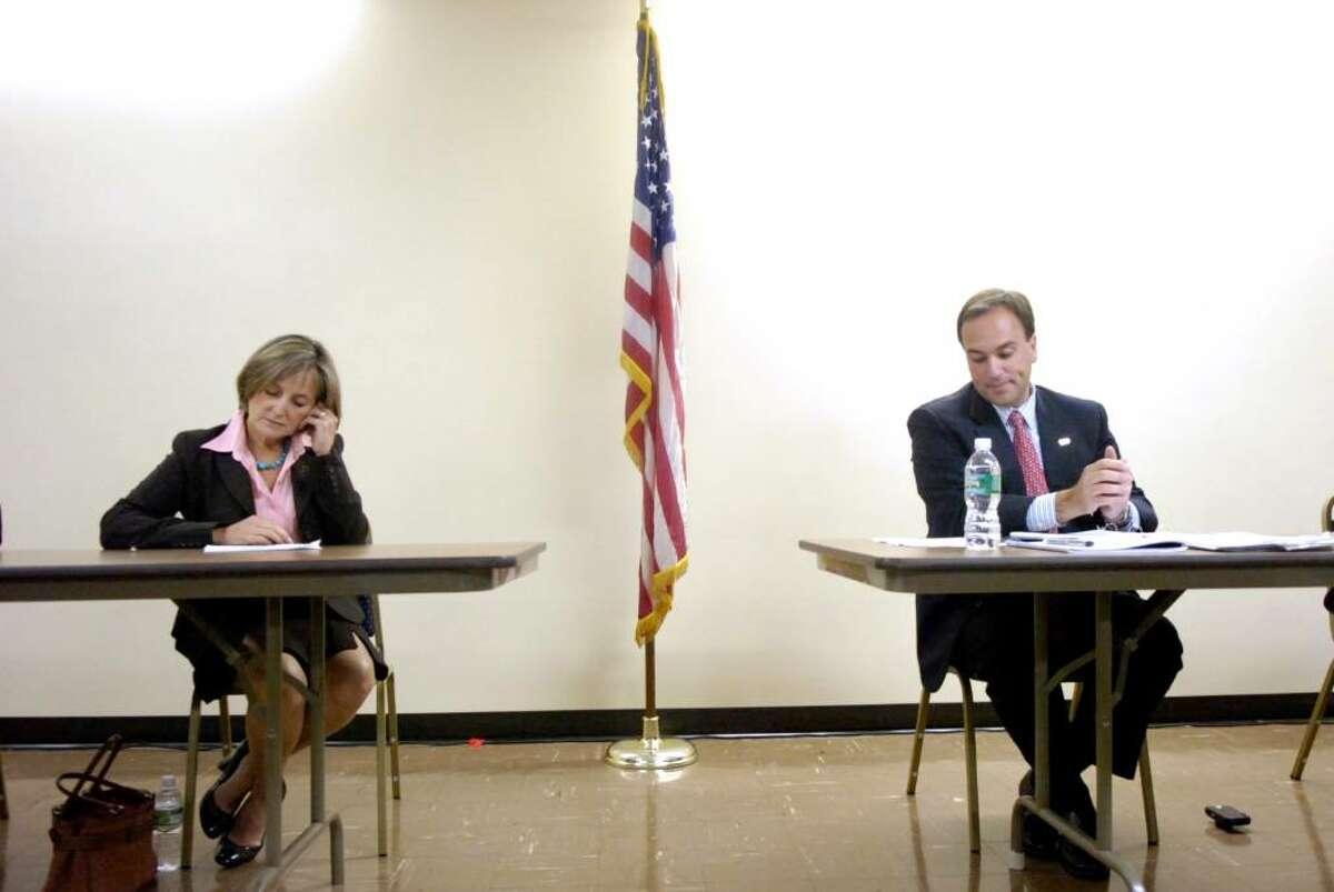 Democrat Lin Lavery and Republican Peter Tesei prepare to debate during
