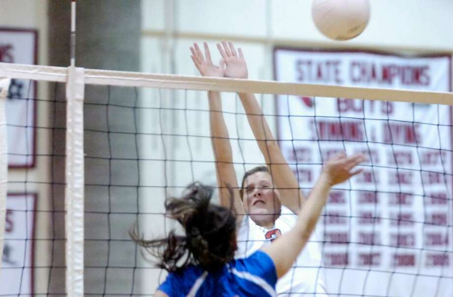 Greenwich High's Michelle Vogt blocks a shot by Ludlowe's Ashley Curtis as Greenwich High School hosts Fairfield Ludlowe High in a girls volleyball game. Ludlowe won the match 3-1 Photo: Keelin Daly / Greenwich Time