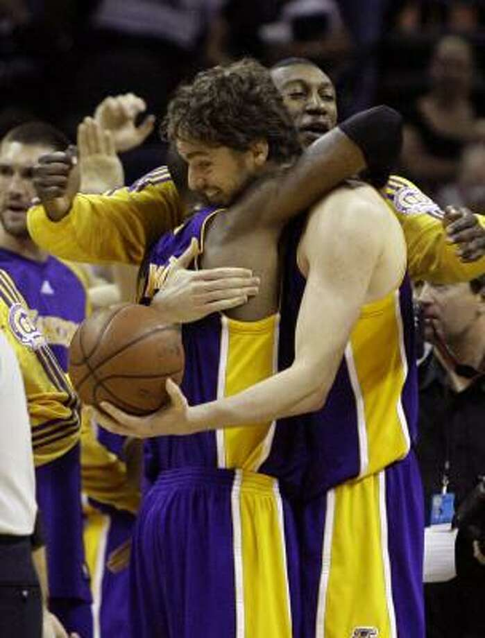 Los Angeles Lakers guard Kobe Bryant, left, and Lakers center Pau Gasol celebrate their 93-91 win over the San Antonio Spurs in Game 4 of the Western Conference finals on Tuesday in San Antonio. Photo: Matt Slocum, AP