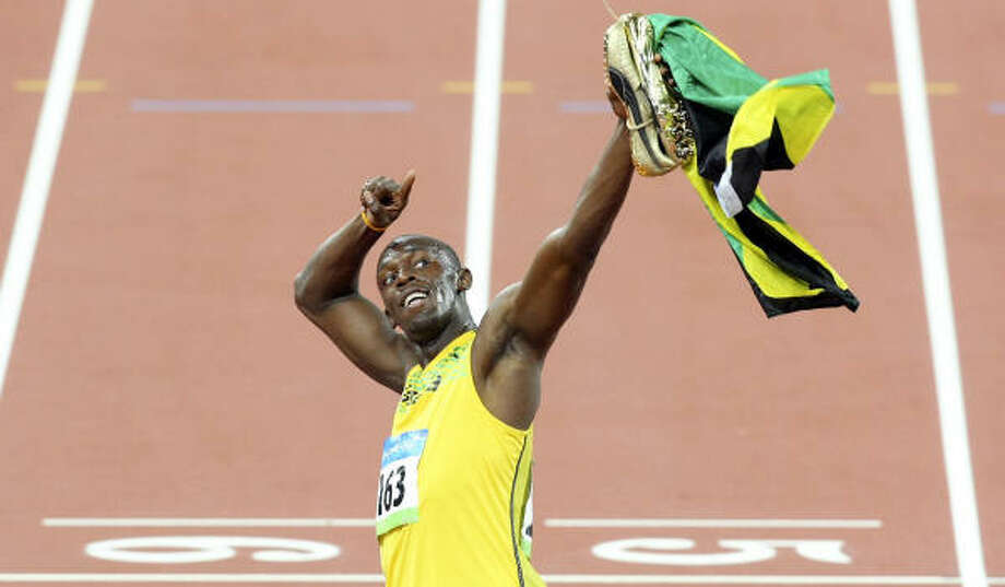 Usain Bolt has the record in the 100, and it's not even his main event. He said he ran it to prepare for the 200. Photo: EDWARD A. ORNELAS, SAN ANTONIO EXPRESS-NEWS