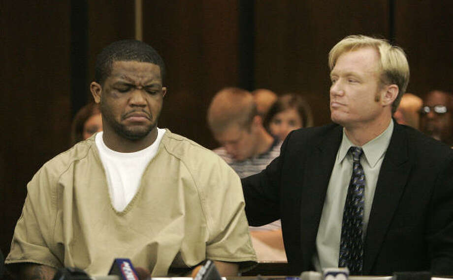 Maurice Clarett nods his head as he listens to his attorney Nick Mango on Friday in Columbus, Ohio. Clarett, arrested after a bizarre and violent encounter in which he was caught by police with four guns following a chase, has been ordered to have a mental health evaluation against his wish. Photo: KIICHIRO SATO, AP