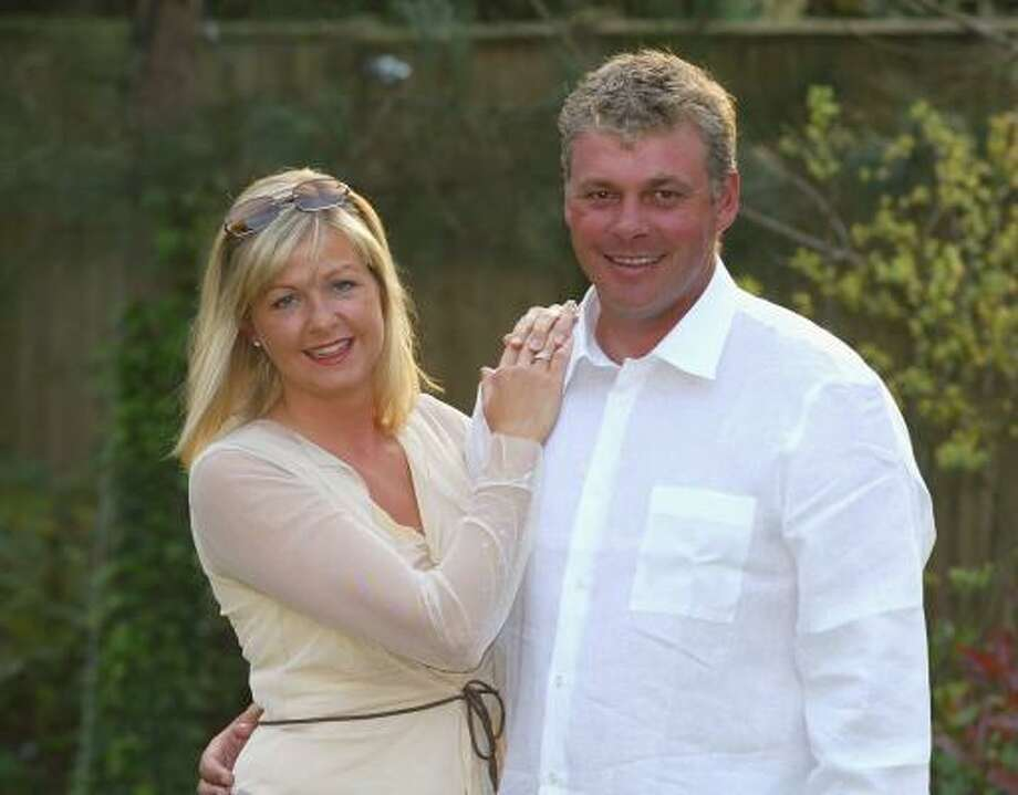 Darren Clarke of Northern Ireland poses with his wife Heather at their home in Sunningdale, Surrey. Heather Clarke died in the early hours of Sunday August 13, 2006 after long battle with breast cancer aged 39. Photo: David Cannon, Getty Images