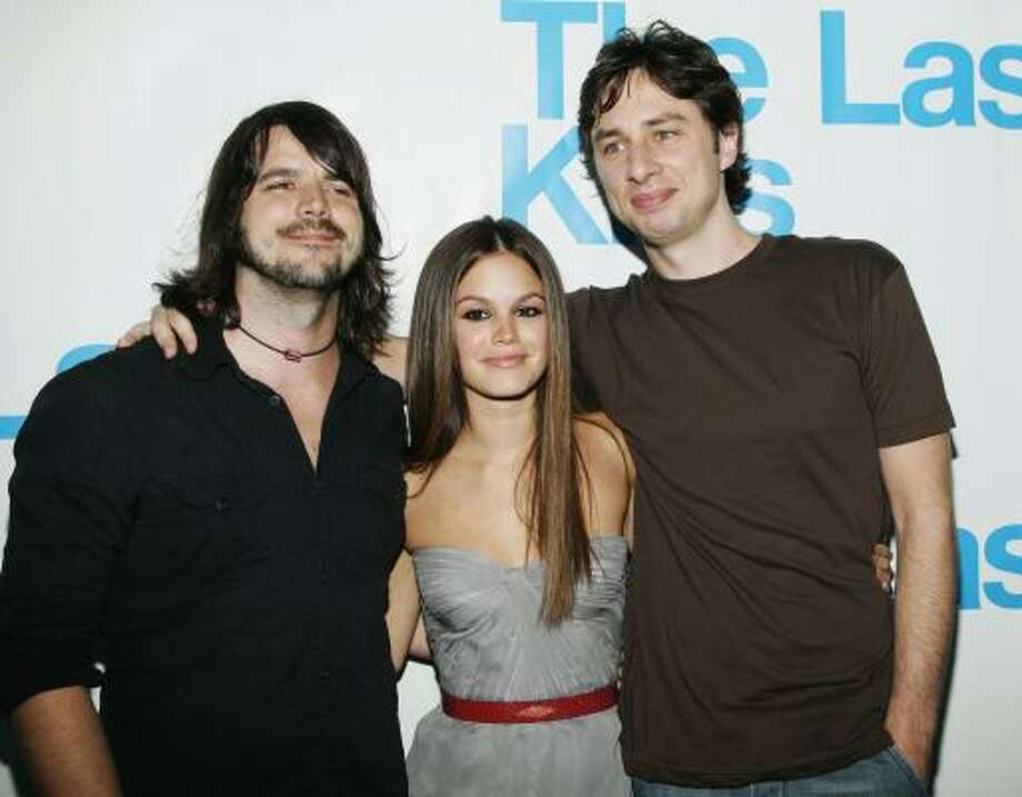 Cary Brothers, left, who appeared on the Garden State soundtrack poses with Rachel Bilson and Zach Braff at the listening party for The Last Kiss soundtrack last week. Photo: Vince Bucci, Getty Images